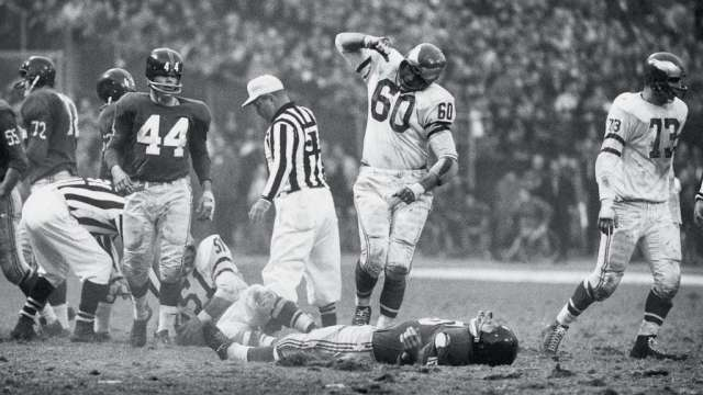 UNITED STATES - NOVEMBER 20:  Football: Philadelphia Eagles Chuck Bednarik (60) victorious after making sack vs New York Giants Frank Gifford (16), Bronx, NY 11/20/1960  (Photo by John G. Zimmerman/Sports Illustrated/Getty Images)  (SetNumber: X7149)